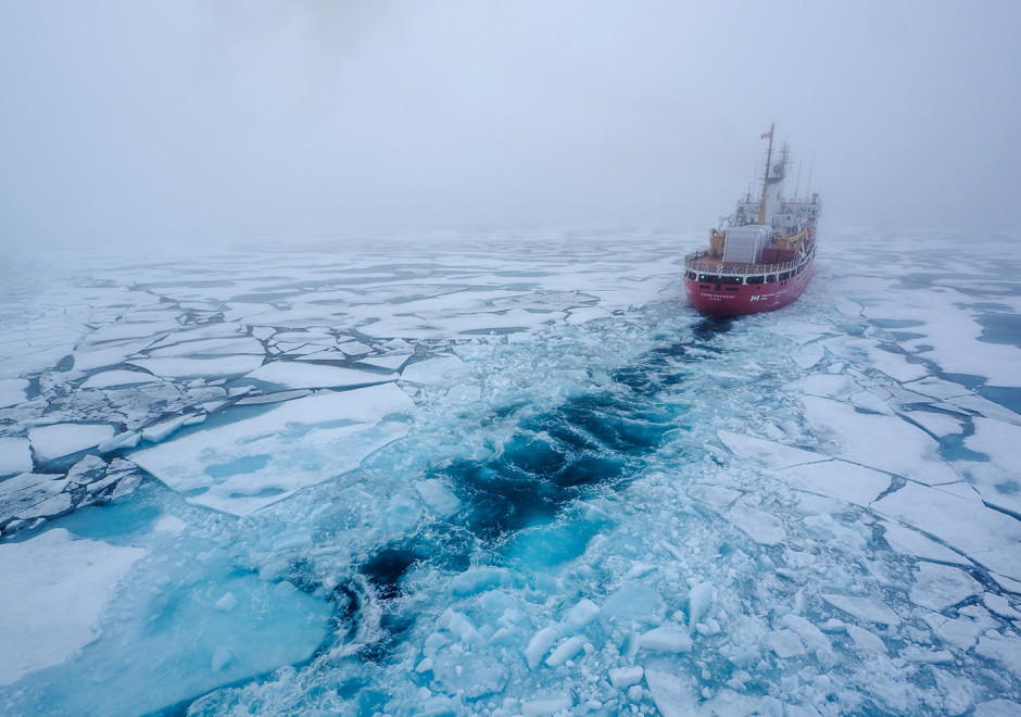 Canadian icebreaker cutting through multi-year ice in the Northwest Passage