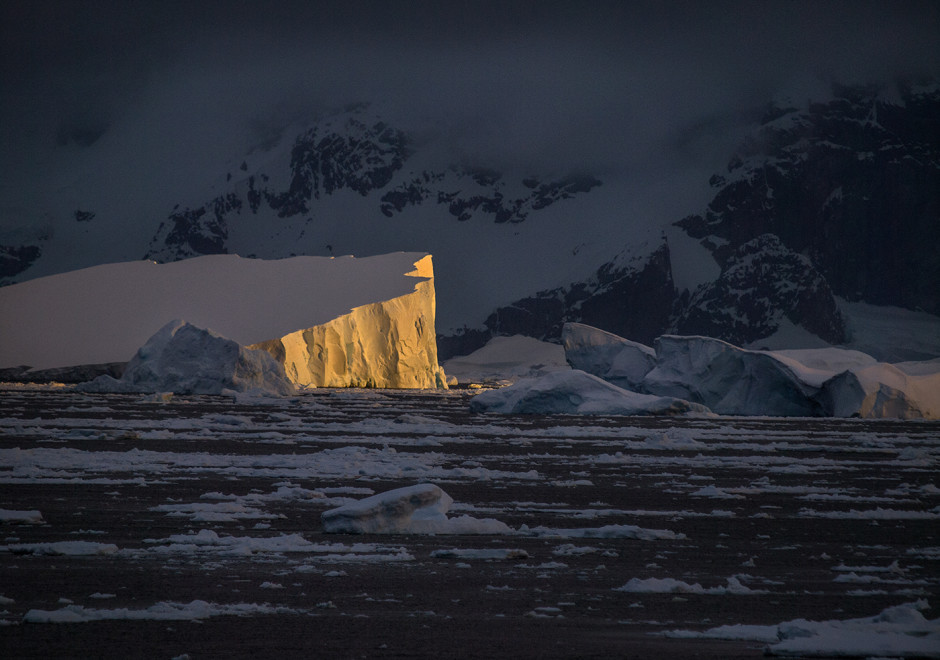 Late day sun breaks out on tabular icebergs in Grand Didier Channel in Antarctica